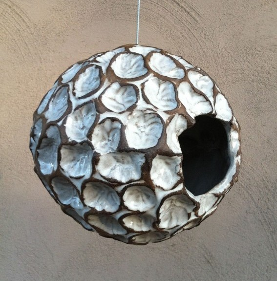 Pearl White Wave Orb - This handmade orb is very versatile and can be used as a bird house, bird feeder or hanging planter. It measures about 9″ and has small drainage holes on the bottom. I use a stainless steel cable which measures about 18″ in length and is rated to hold 120 lbs.
